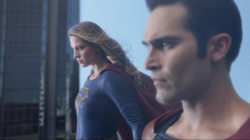 Supergirl and Superman flying together