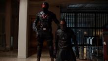 Mr. Terrific held hostage by Vigilante