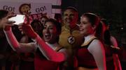 Kid Flash with cheerleaders