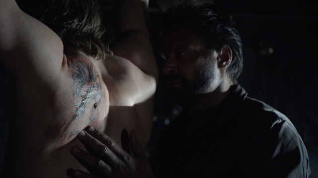File:Slade brands Oliver's back with the same tattoo that Shado had.png