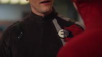 Barry gives Ralph the Elongated Man emblem
