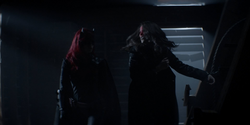 Batwoman defeats and handcuffs Nocturna
