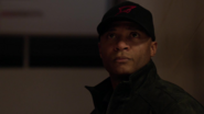 John Diggle wearing a Starling Rockets cap