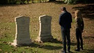 Oliver and Mia in front of Emiko and Robert's graves