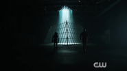 The Arrow and Flash walk towards the Superhero Fight Club ring