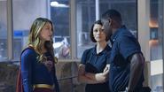 Supergirl team meeting