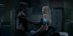 Sophie tends to Julia's wound