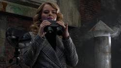 Eve oversees the meeting at Kara Danvers' apartment