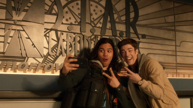 File:Cisco Ramon and Barry Allen taking selfies with the S.T.A.R. Laboratories sign.png