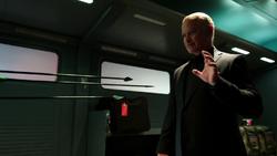 Damien Darhk stops the Green Arrow's arrows