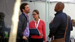 Maxell Lord with James Olsen and Kara Danvers bandaged