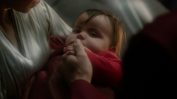 Baby Kal-El being held by his parents