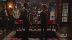 Dion and Sara shake hands before beer pong