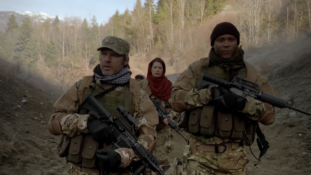 File:Diggle and Lyla in Afghanistan.png