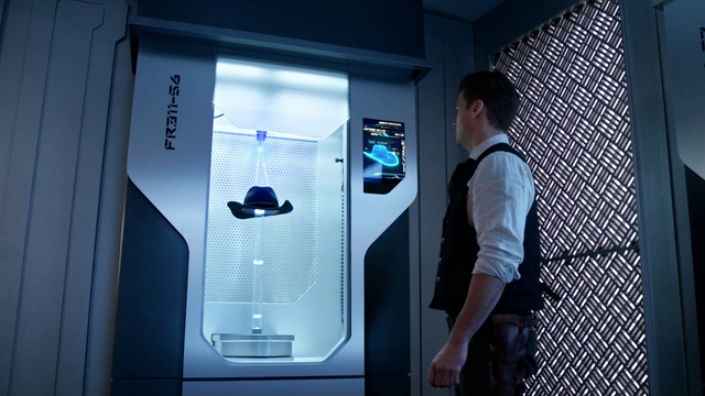 File:The Waverider's fabrication room produces a stetson for Nate Heywood.png