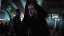 Mia Smoak in a black hood