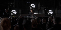 Catherine make a speech at the switching off of the Bat-Signal