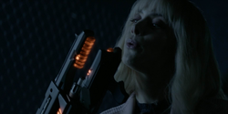 Alice shows to Rifle that the Hamilton Dynamics weapon works