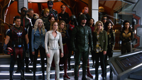 Earth-1 heroes and Earth-X rebels listens to Oliver of Earth-X's bargain
