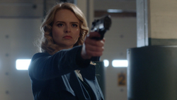 Eve holds William Dey at gunpoint