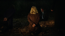 Oliver watch as Slade holds his mother and sister at gunpoint