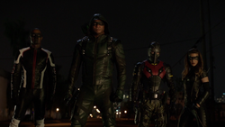 Team Arrow in the field led by John Diggle