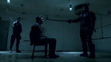 Slade points a katana at Oliver