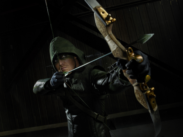 File:The Hood aiming his bow promo.png