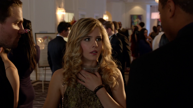 File:Felicity strapped with a collar bomb.png