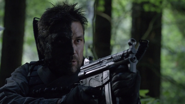 File:Slade Wilson with a half-covered face.png
