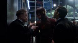 James Jesse explains the kinetic bomb to The Flash