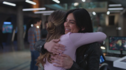 Kara and Maggie hug