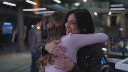 Kara and Maggie hug