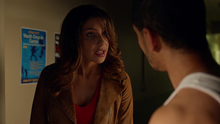 Dinah warns Rene that she'll arrest him the next time he goes out as Wild Dog