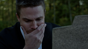 Oliver shedding tears over a grave