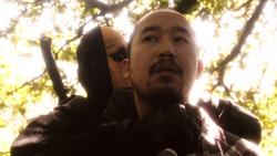 Slade interrogating Ming