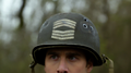 Sgt. Rock's helmet on his head.png