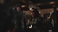 Black Canary uses her scream on Parks