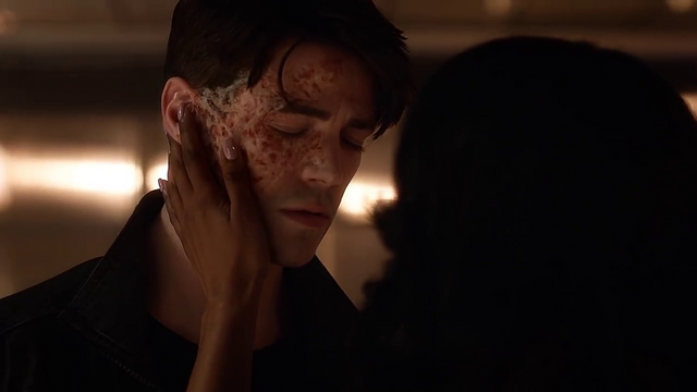File:Iris touches Savitar's face.png