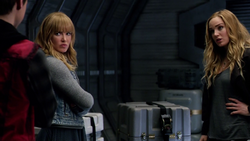 Sara Lance talks to the younger versions of herself and Mick Rory