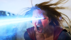 Supergirl angrily firing a blast of heat vision at Red Tornado