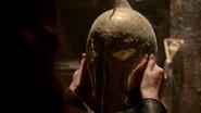 Zed holds a gold helmet