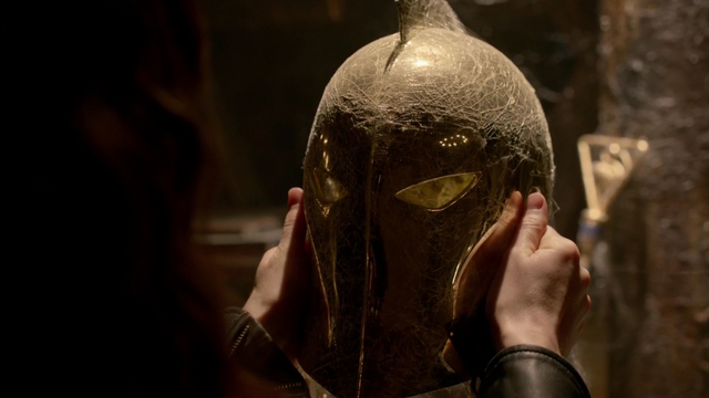 File:Zed holds a gold helmet.png