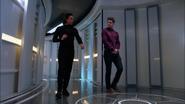Brainy and Winn in the Legion cruiser's corridor