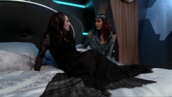 Rhea with Lena as she awakens on her ship