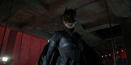 Kate Kane looks down on Gotham in her repurposed Batman suit