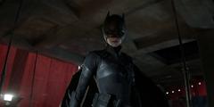 Kate Kane looks down on Gotham in her repurposed Batman suit