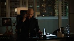 Lex orders Brainiac-5 to keep an eye on Alex