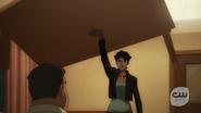 Mari lifts up a table