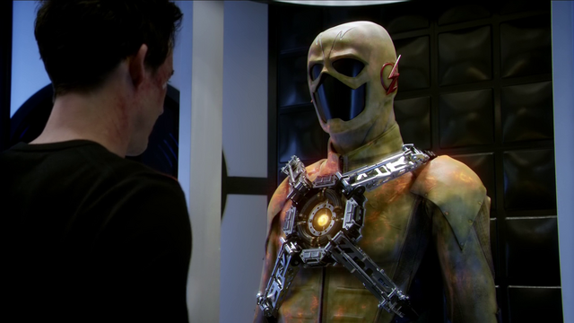 File:Harrison Wells looks at the modified yellow suit.png